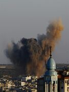 Smoke, dust and debris rise after an Israeli strike hit Gaza City in the northern Gaza Strip, Wednesday, Aug. 20, 2014. (AP Photo/Adel Hana)
