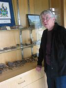 Headingley Historical Society member Jean Ammeter stands next to a display case in the Headingley Community Centre which holds artifacts from the municipality's past.