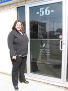 Portage la Prairie Community Revitalization Corporation executive director Elicia Funk stands outside the organization's office at Unit B,  56 Royal Road N in Portage la Prairie.