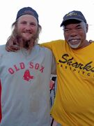 Denver Sellner (left) is 22 years old, the youngest player in the Crestview Men's Fastball League. He is standing next to Donny Ross, 72, the oldest player in the league.