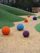 "Some of the large rubber balls called ""Skittles"" at the Assiniboine Park's Nature Playground are shown. Three of the balls were stolen from the park July 14 but have since been returned after police received a tip as to their whereabouts."