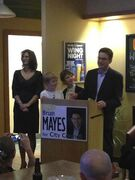 Brian Mayes with his wife, Alison Marshall, and two sons, on election night.