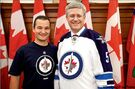 Prime minister falls in love with Jets jersey, signs up for waiting list
