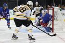 Marchand, Bergeron lead Bruins to 7-4 win over Rangers