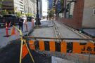 Narrowed sidewalk site of pedestrian-vehicle conflict