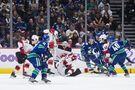 Devils score two quick goals, hold on to beat Canucks 2-1