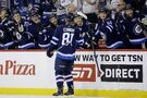 Connor nets first NHL hat trick as Jets lock up playoff berth