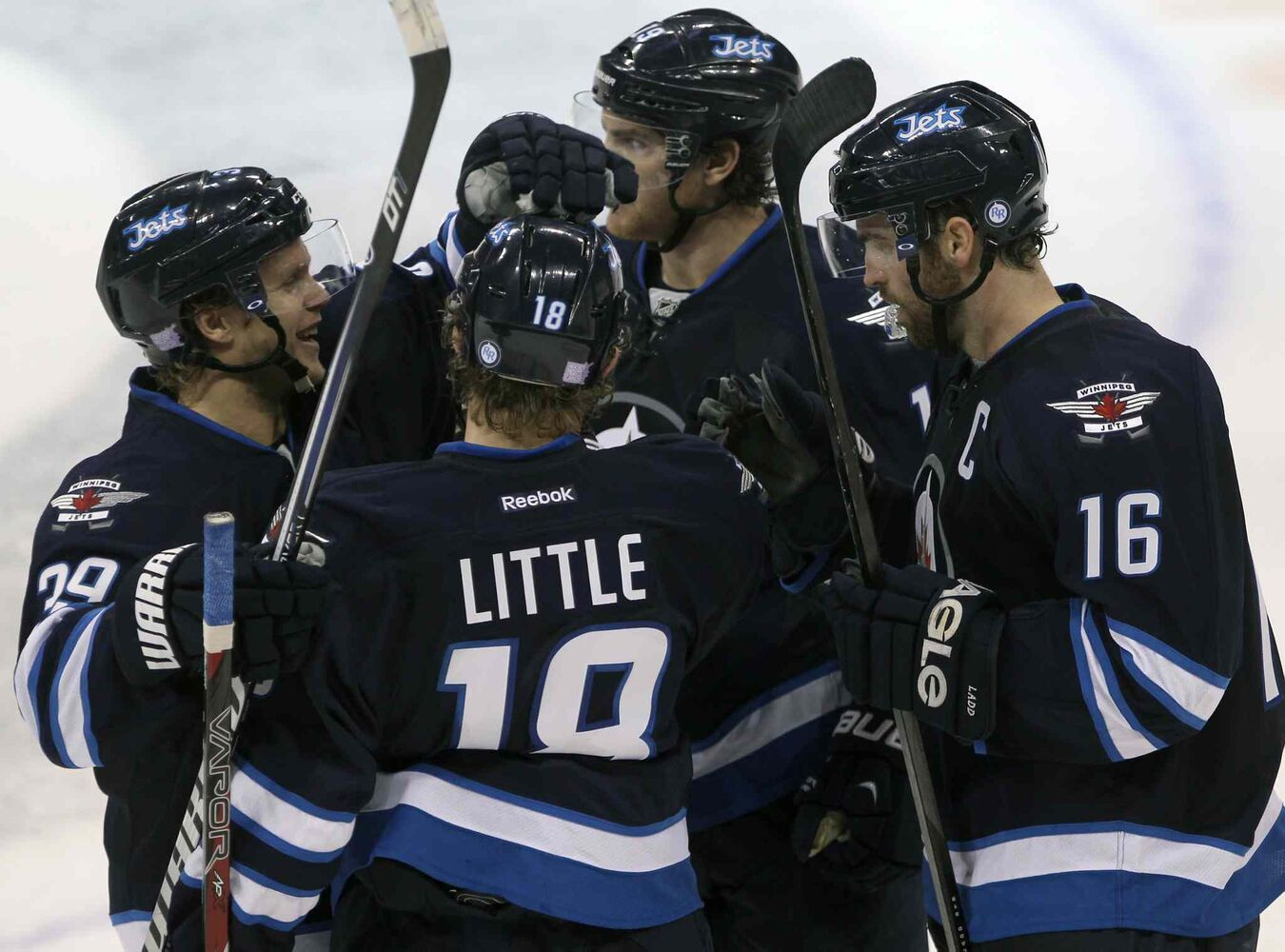 Winnipeg Jets (from left) Tobias Enstrom, Bryan Little, Jim Slater and Andrew Ladd celebrate the team's late empty-net goal in the third period, giving the Jets a 5-3 win over the Los Angeles Kings. (JOE BRYKSA / WINNIPEG FREE PRESS)