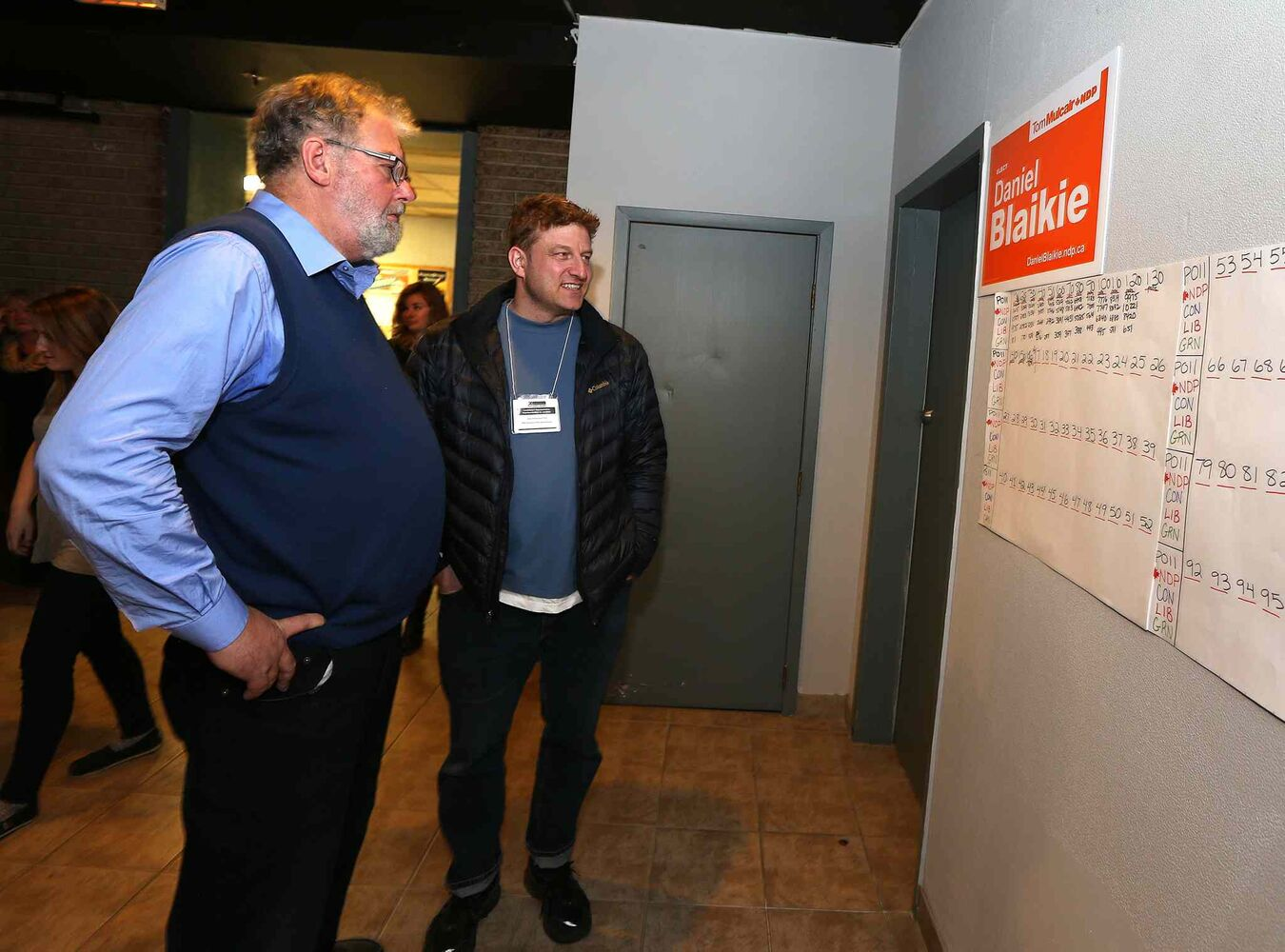 Former MP Bill Blaikie checks out the vote tally for his son, NDP candidate for Elmwood-Transcona, Daniel Blaikie, at the New Cavalier Inn on Regent Avenue West on Mon., Oct. 19, 2015.  (Jason Halstead / Winnipeg Free Press)