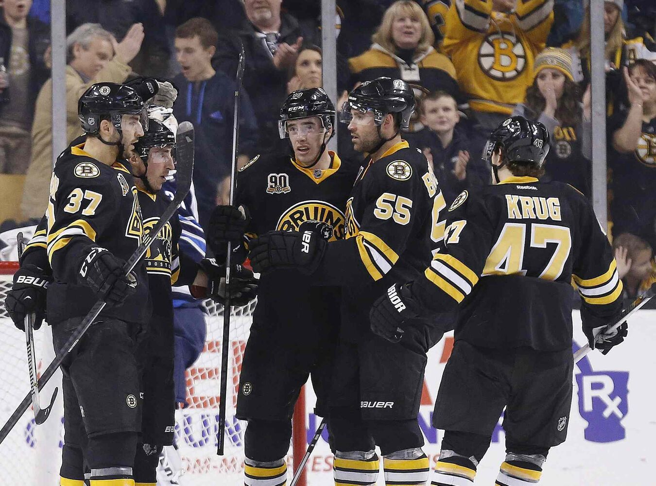 Boston Bruins' Reilly Smith, centre, celebrates his goal with teammates Patrice Bergeron (37), Brad Marchand (63), Johnny Boychuk (55) and Torey Krug (47) in the third period Saturday. The Bruins won the game 4-1. (Michael Dwyer / The Associated Press)