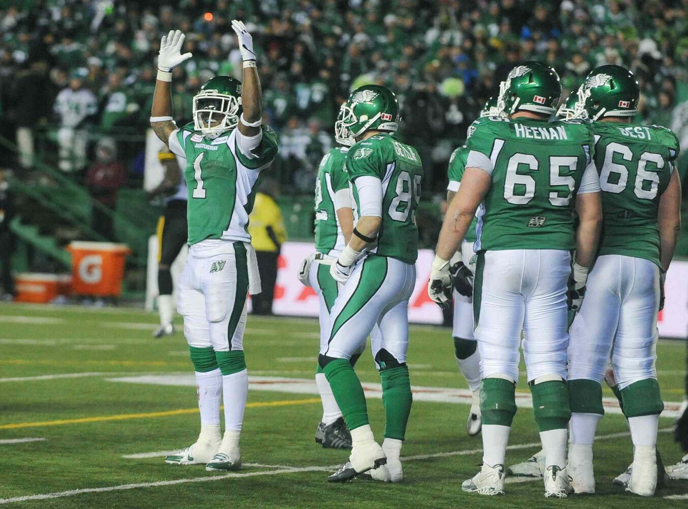 Saskatchewan Roughriders running back Kory Sheets (left) celebrates his team's victory over the Hamilton Tiger-Cats.