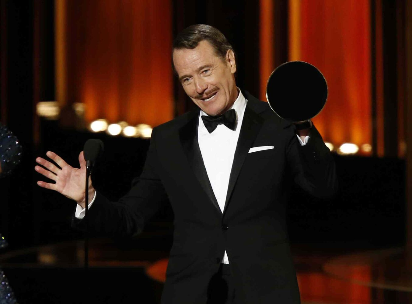 Bryan Cranston accepts the award for Outstanding Lead Actor In A Drama Series for his role in Breaking Bad during the 66th Primetime Emmy Awards in Los Angeles. His co-stars Anna Gunn and Aaron Paul also won for their supporting roles and the show took home an Emmy for outstanding drama series.