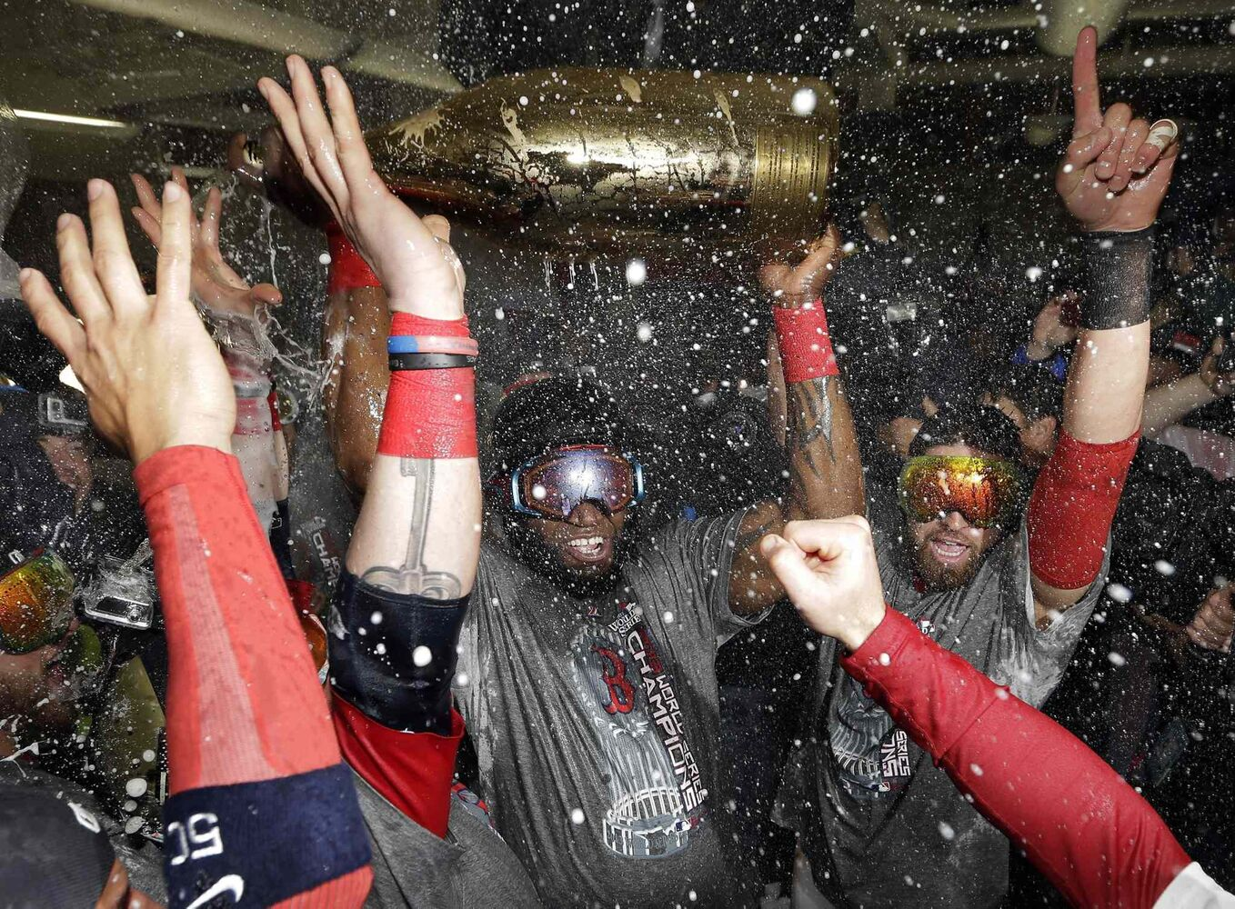 Boston Red Sox's David Ortiz celebrates with teammates.