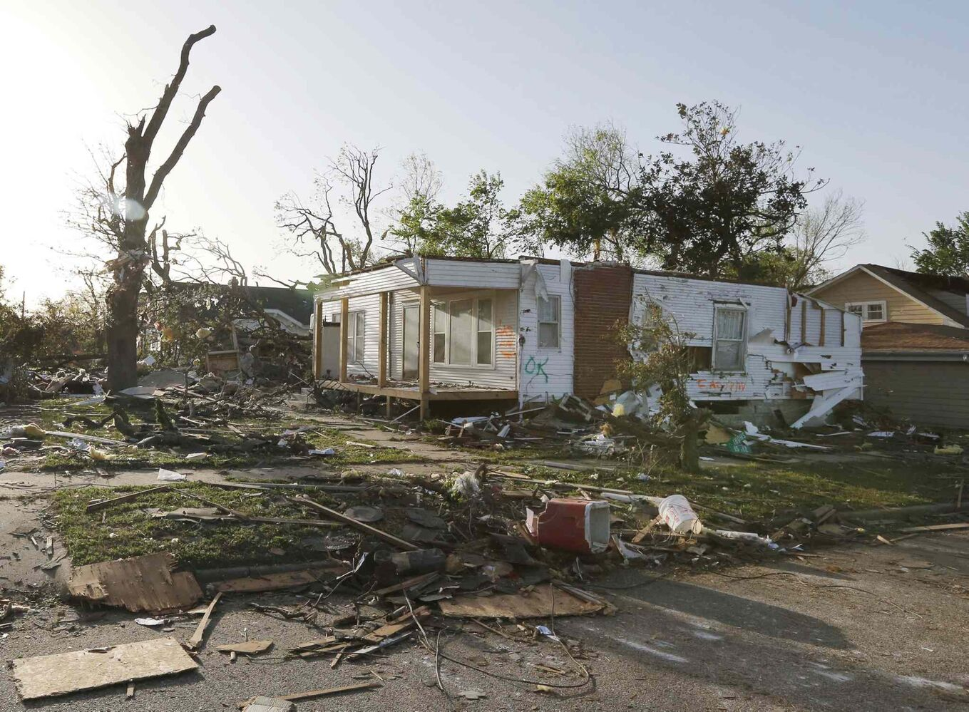 A home damaged by a tornado stands without a roof in Baxter Springs, Kan., Monday, April 28, 2014. (Orlin Wagner / The Associated Press)