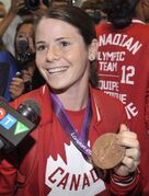 Canadian Olympic women's soccer player Diana Matheson is a leader for the Canadian team on and off the field. Matheson is shown holding up her bronze medal as she arrives home at Pearson airport in Toronto on Monday, August 13, 2012. THE CANADIAN PRESS/J.P. Moczulski