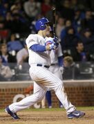 Chicago Cubs' Anthony Rizzo, watches his walk-off home run off Cincinnati Reds relief pitcher Pedro Villarreal, giving the Cubs a 1-0 win during the ninth inning of a baseball game Monday, Sept. 15, 2014, in Chicago. (AP Photo/Charles Rex Arbogast)