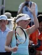 Caroline Wozniacki, of Denmark, waves after defeating Madison Brengle 6-0, 6-1 at the Miami Open tennis tournament, Thursday, March 26, 2015, in Key Biscayne, Fla. (AP Photo/Lynne Sladky)