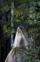 A model wears a creation by fashion designer Elie Saab during his Spring-Summer 2015 Haute Couture fashion collection, presented in Paris, France, Wednesday, Jan. 28, 2015. (AP Photo/Francois Mori)