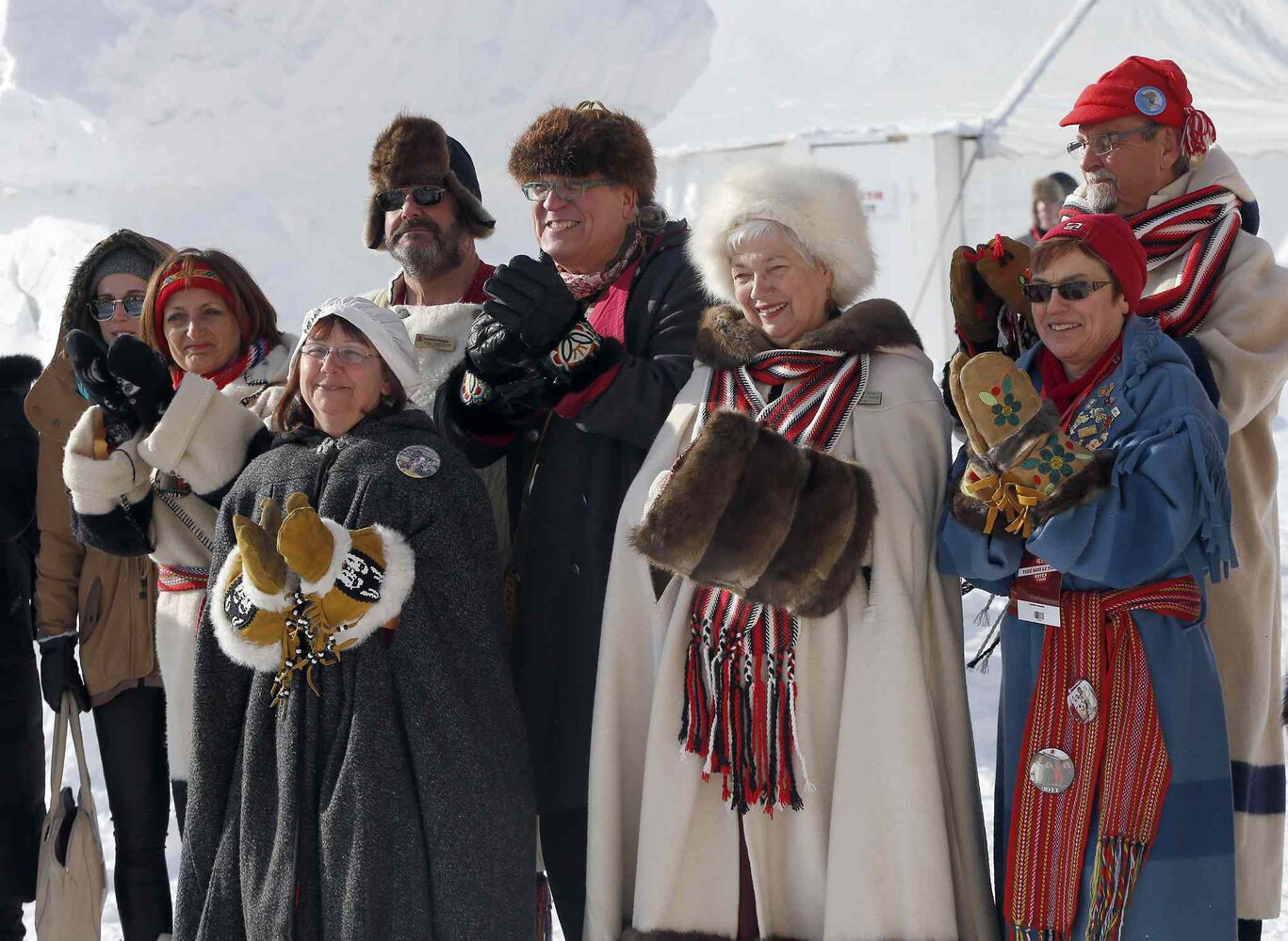 Enthusiastic festival ambassadors attend the kick-off ceremony for the 45th Festival du Voyageur. The festival runs Feb. 14 to 23 and is to include a torchlight walk, international snow sculpture competition, music and entertainment and the creation of the world's largest living Metis Flag on Louis Riel Day.  (KEN GIGLIOTTI / WINNIPEG FREE PRESS)