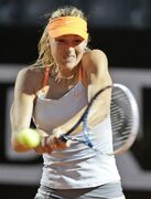 Russia's Maria Sharapova returns the ball to US Sloane Stephens during their match at the Italian Open tennis tournament in Rome, Thursday, May 16, 2013. (AP Photo/Andrew Medichini)