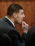 Former New England Patriots football player Aaron Hernandez listens during his murder trial Friday, March 6, 2015, in Fall River, Mass. Hernandez is charged with killing semiprofessional football player Odin Lloyd. (AP Photo/The Boston Herald, Ted Fitzgerald, Pool)