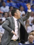 Memphis Grizzlies head coach David Joerger shouts to his team in the second quarter of Game 2 of an opening-round NBA basketball playoff series against the Oklahoma City Thunder in Oklahoma City, Monday, April 21, 2014. (AP Photo/Sue Ogrocki)