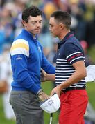 Europe's Rory McIlroy, left, shakes hands with Rickie Fowler of the US, after winning his match on the 14th hole during the singles match on the final day of the Ryder Cup golf tournament, at Gleneagles, Scotland, Sunday, Sept. 28, 2014. (AP Photo/Peter Morrison)