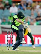 Ireland's Ed Joyce ducks under a ball from South Africa's Dale Steyn during their Cricket World Cup Pool B match in Canberra, Australia, Tuesday, March 3, 2015. (AP Photo/Rob Griffith)