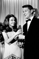 FILE - In this April 10, 1968, file photo, French actress-dancer Leslie Caron presents the Oscar for best director for the movie