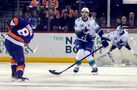 Hughes, Schaller lead Canucks past Islanders 4-3