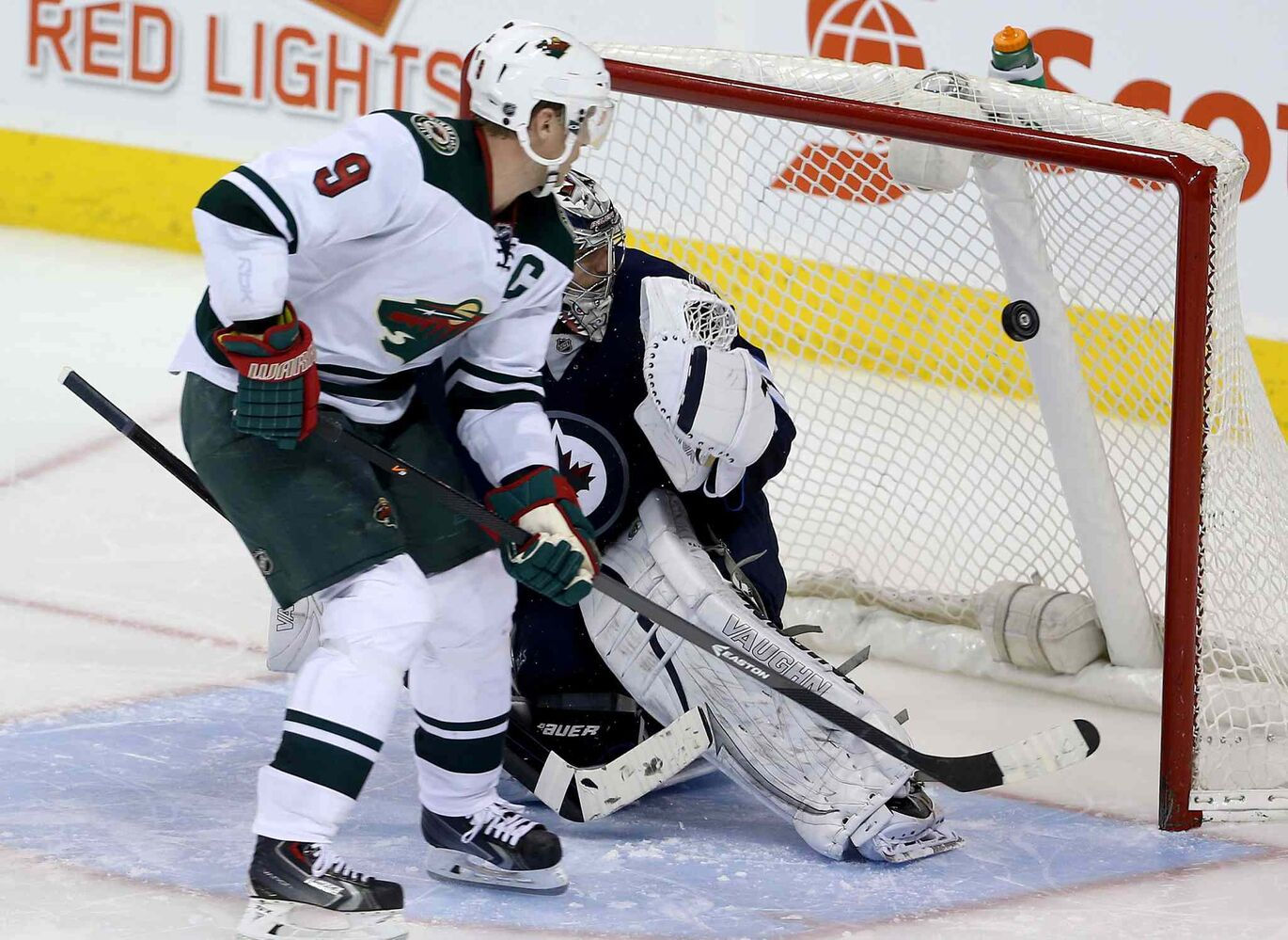 Minnesota Wild's Mikko Koivu beats Winnipeg Jets goaltender Ondrej Pavelec during the shootout. (TREVOR HAGAN / WINNIPEG FREE PRESS)