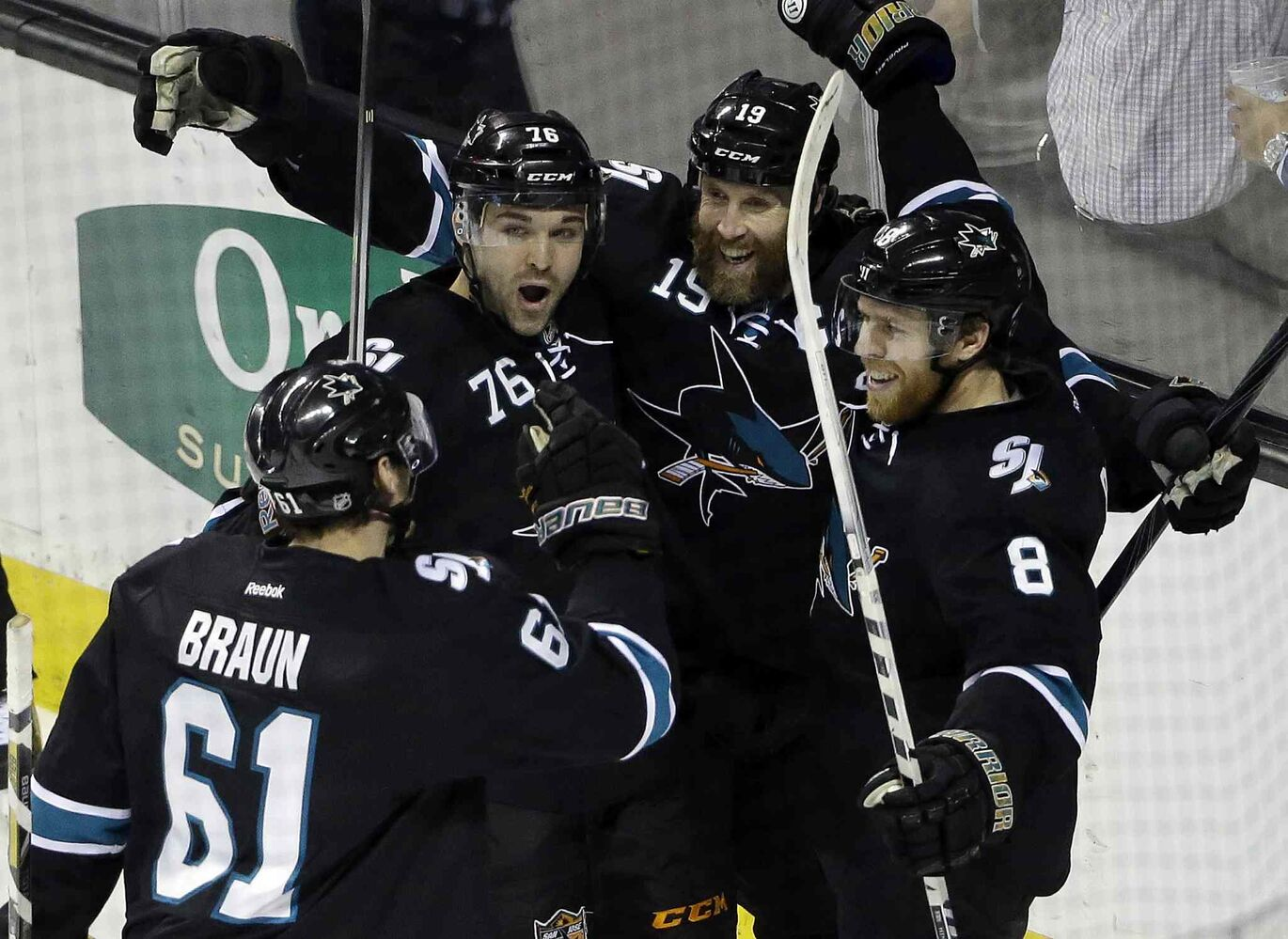 San Jose Sharks' Joe Pavelski (8) celebrates his goal with teammates during the third period of an NHL hockey game against the Winnipeg Jets on Thursday. San Jose won 1-0. (Marcio Jose Sanchez / The Associated Press)