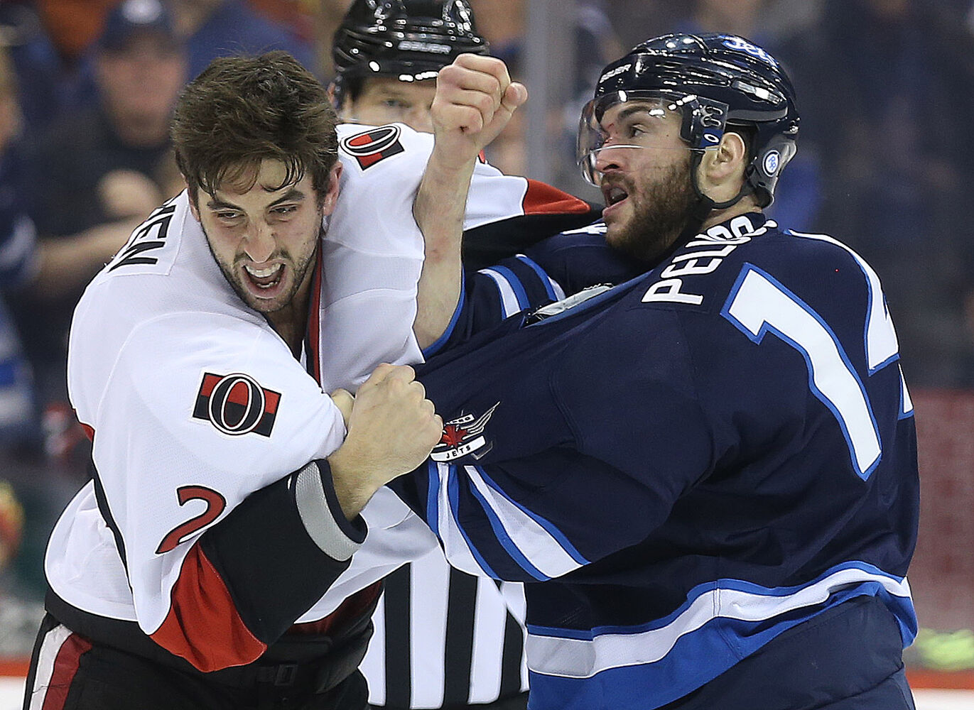 Ottawa Senators' Jared Cowen (2) fights Winnipeg Jets' Anthony Peluso (14) during the second period.