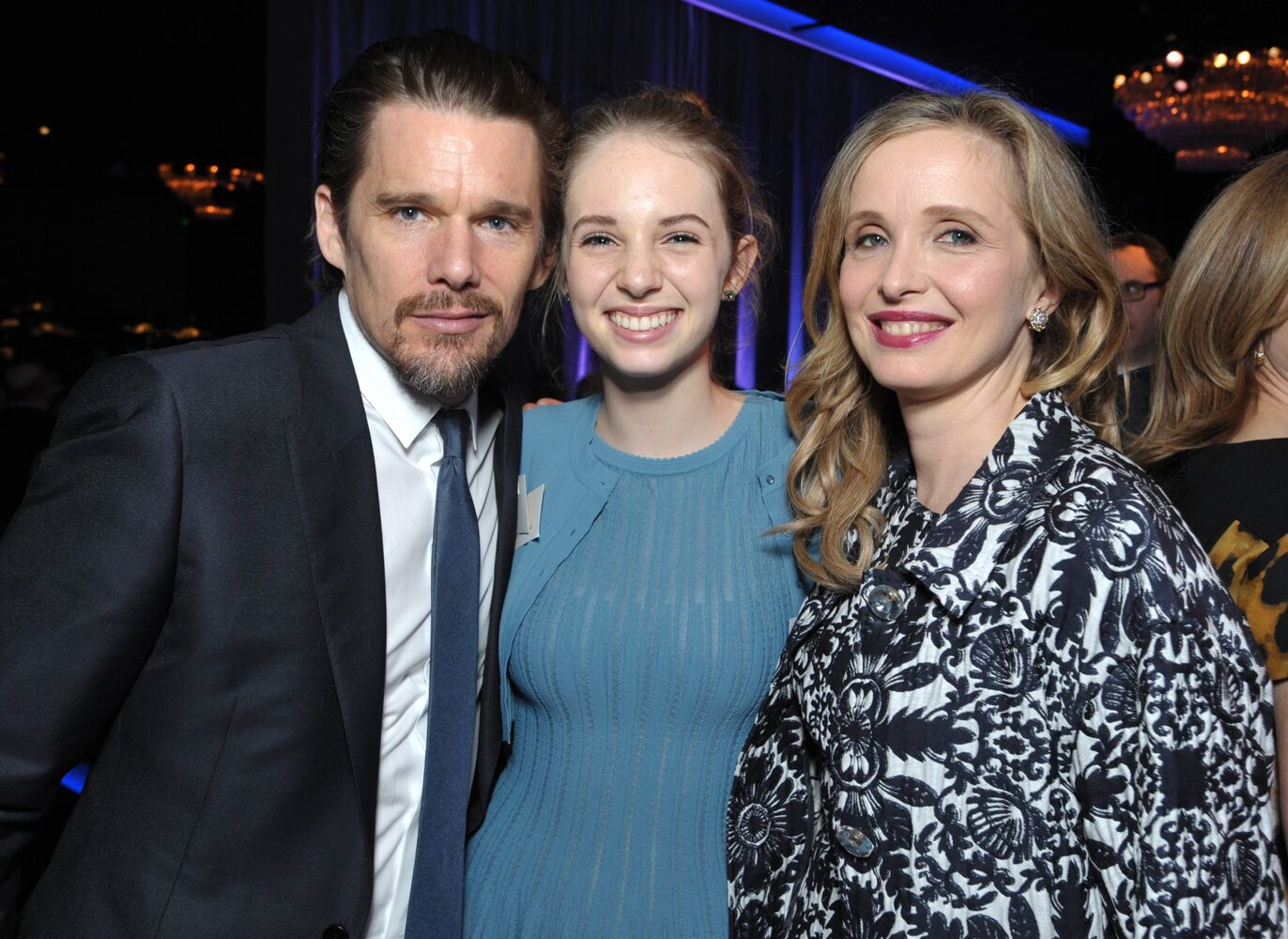 From left, Ethan Hawke, his daughter Maya Thurman-Hawke and Julie Delpy are all smiles as they celebrate the handful of awards Before Midnight is up for this year.  (John Shearer / Invision / AP)