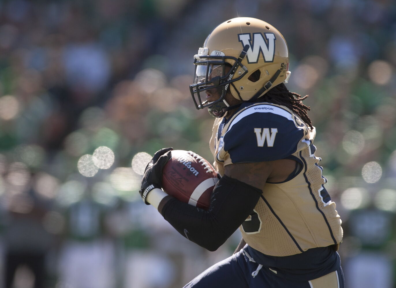 Bombers running back Nic Grigsby runs in a touchdown during the first quarter. (Liam Richards / THE CANADIAN PRESS)