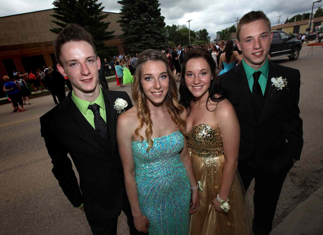 Lavich quadruplets, from left, Greg, Maryn, Janelle, and Myles were part of the graduation procession on Carberry's main street Wednesday. (Phil Hossack / Winnipeg Free Press)