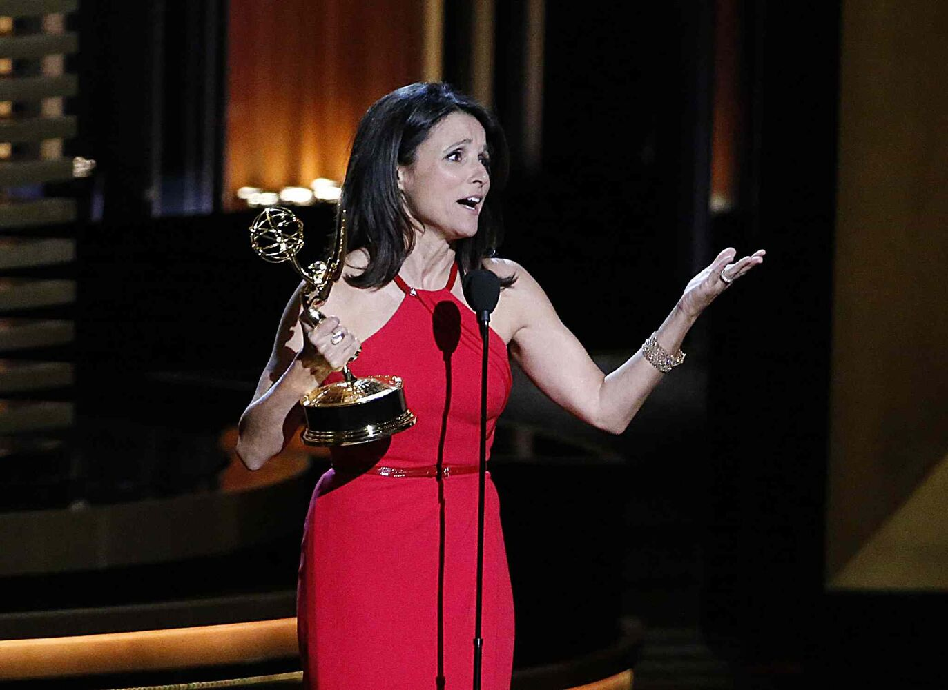 Julia Louis-Dreyfus accepts her Emmy for Best Actress in a Comedy Series for Veep. (Tribune Media MCT)
