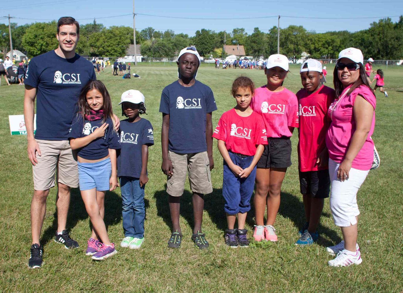 The second annual Canadian Jumpstart Games were held at Sinclair Park Community Centre on July 30, 2015. Hundreds of children from Boys and Girls Clubs of Winnipeg's community school investigators (CSI) program took part. The children were from 14 different schools in Winnipeg School Division. The games are sponsored and supported by Canadian Tire and its associated store chains. Pictured, from left, are Mitch Ferreira, Jordan, Therese, Hamed, Demi, Priskila, Nicholas and Kamal Saggi. (JOHN JOHNSTON FOR THE WINNIPEG FREE PRESS)