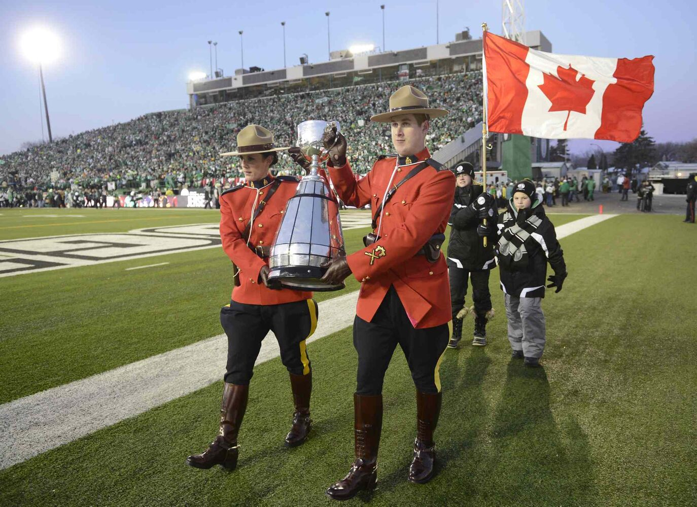 The Grey Cup is carried onto the field during pre-game ceremonies.