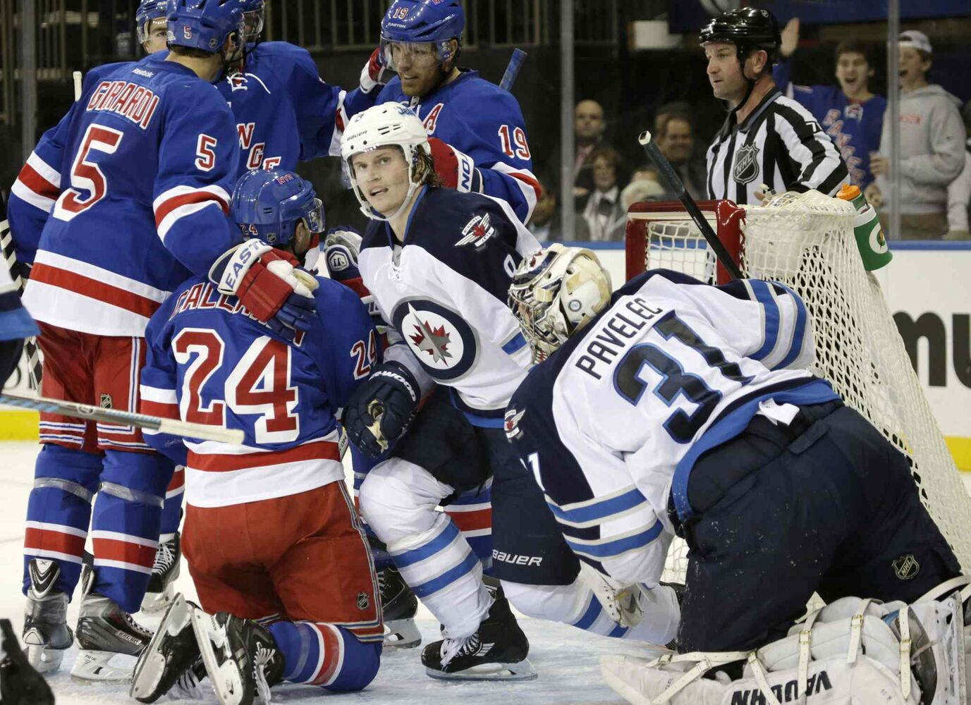New York Rangers' Dan Girardi (5) congratulates Rangers right-winger Ryan Callahan (24) after Callahan scored a goal on Winnipeg Jets goalie Ondrej Pavelec in the second period. Jets defenceman Jacob Trouba (8) watches the replay on the scoreboard. (KATHY WILLENS / THE ASSOCIATED PRESS)