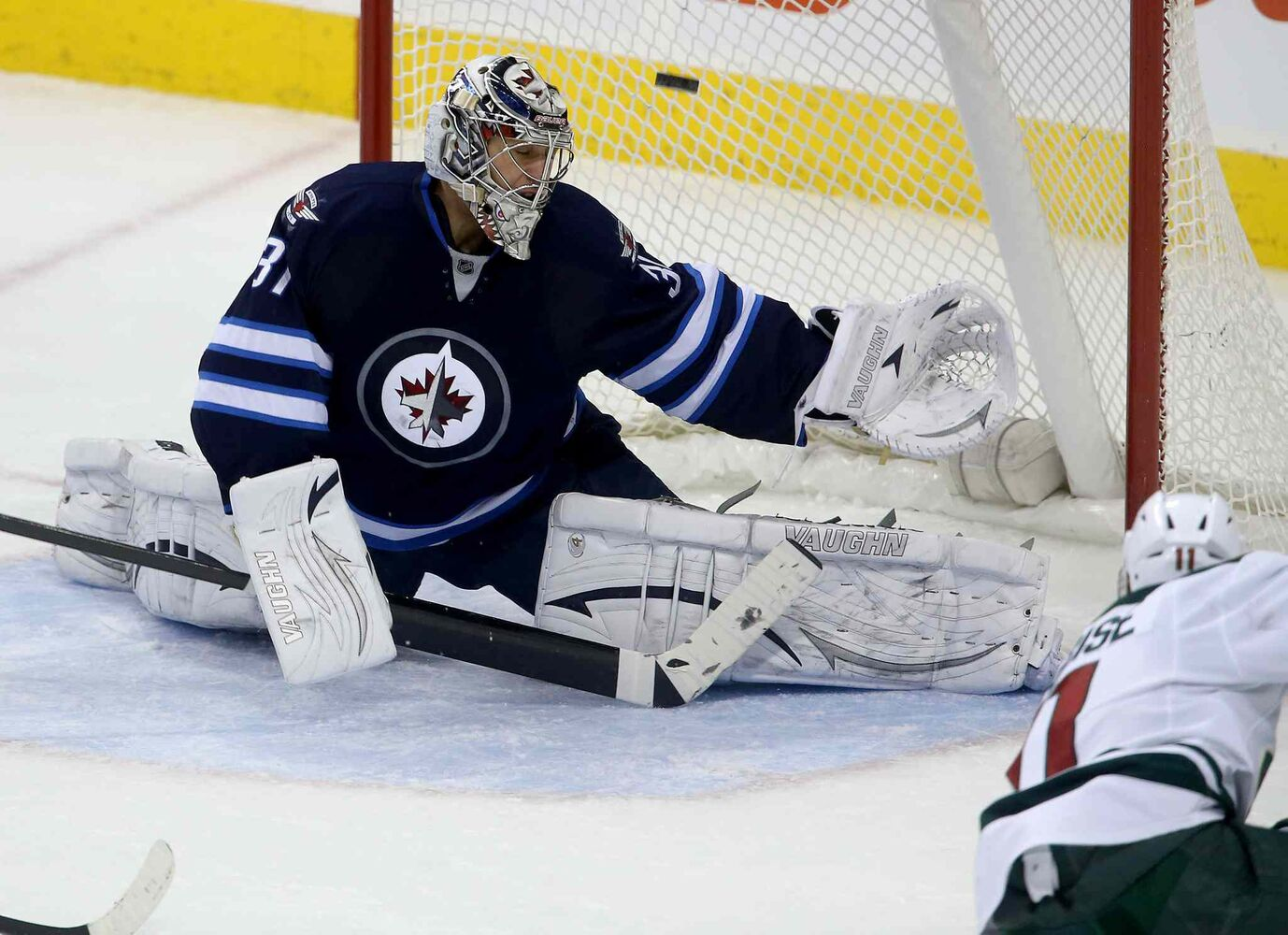 Winnipeg Jets' goaltender Ondrej Pavelec is scored on by Minnesota Wild forward Zach Parise during the third period. (TREVOR HAGAN / WINNIPEG FREE PRESS)