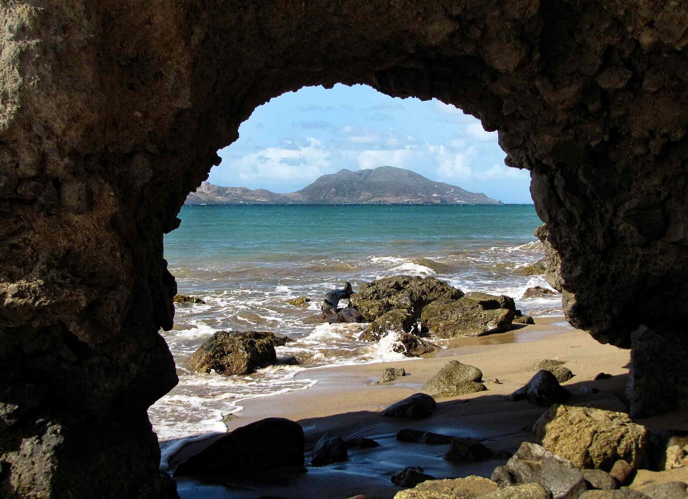 A view of St. Kitts from a quiet beach on the leeward side of Nevis; Nevis is the smaller of the sister islands that make up the Federation of St. Kitts and Nevis, former British colonies.  (Bloomberg archives)