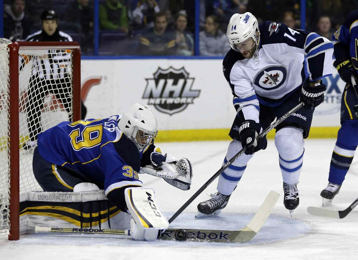 St. Louis Blues goalie Ryan Miller deflects a shot from Winnipeg Jets forward Anthony Peluso during the first period of an NHL game at the Scottrade Center in St. Louis Monday. (JEFF ROBERSON / THE ASSOCIATED PRESS)