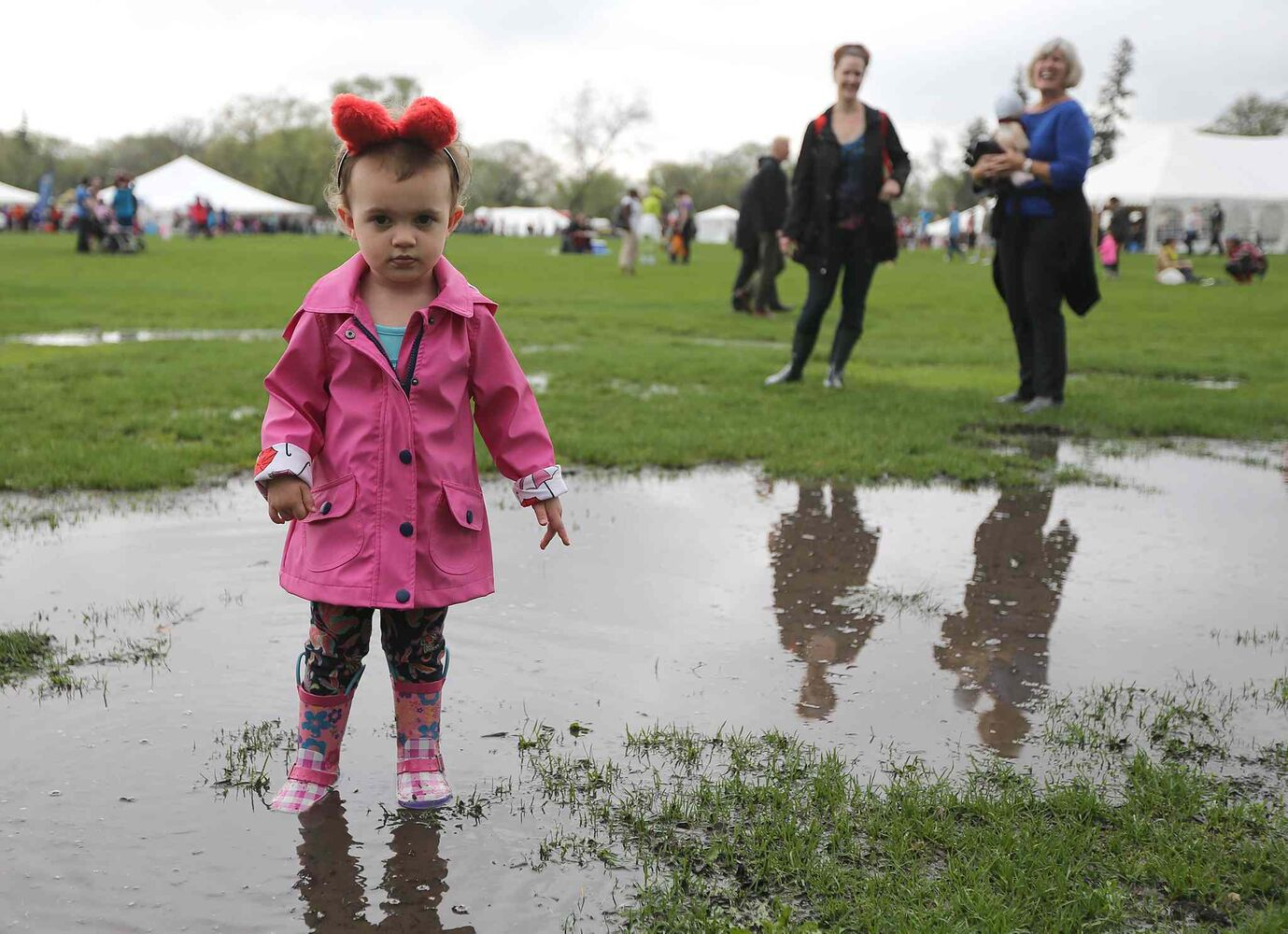 Harlow Woods, 2, sports bear ears while exploring a puddle at  Teddy Bears Picnic. (Jason Halstead)