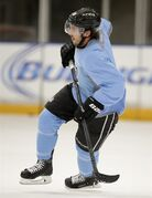 Los Angeles Kings center Mike Richards skates during the team's NHL hockey practice Friday, Sept. 19, 2014, in El Segundo, Calif. The Kings went through their first workouts of training camp Friday as they prepare for their run at a third NHL title in four seasons. (AP Photo/Jae C. Hong)