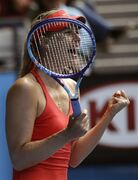 Maria Sharapova of Russia celebrates after defeating her compatriot Ekaterina Makarova in their semifinal match at the Australian Open tennis championship in Melbourne, Australia, Thursday, Jan. 29, 2015. (AP Photo/Bernat Armangue)
