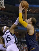 Cleveland Cavaliers center Timofey Mozgov (20) shoots against Memphis Grizzlies guard Vince Carter (15) in the first half of an NBA basketball game Wednesday, March 25, 2015, in Memphis, Tenn. (AP Photo/Brandon Dill)