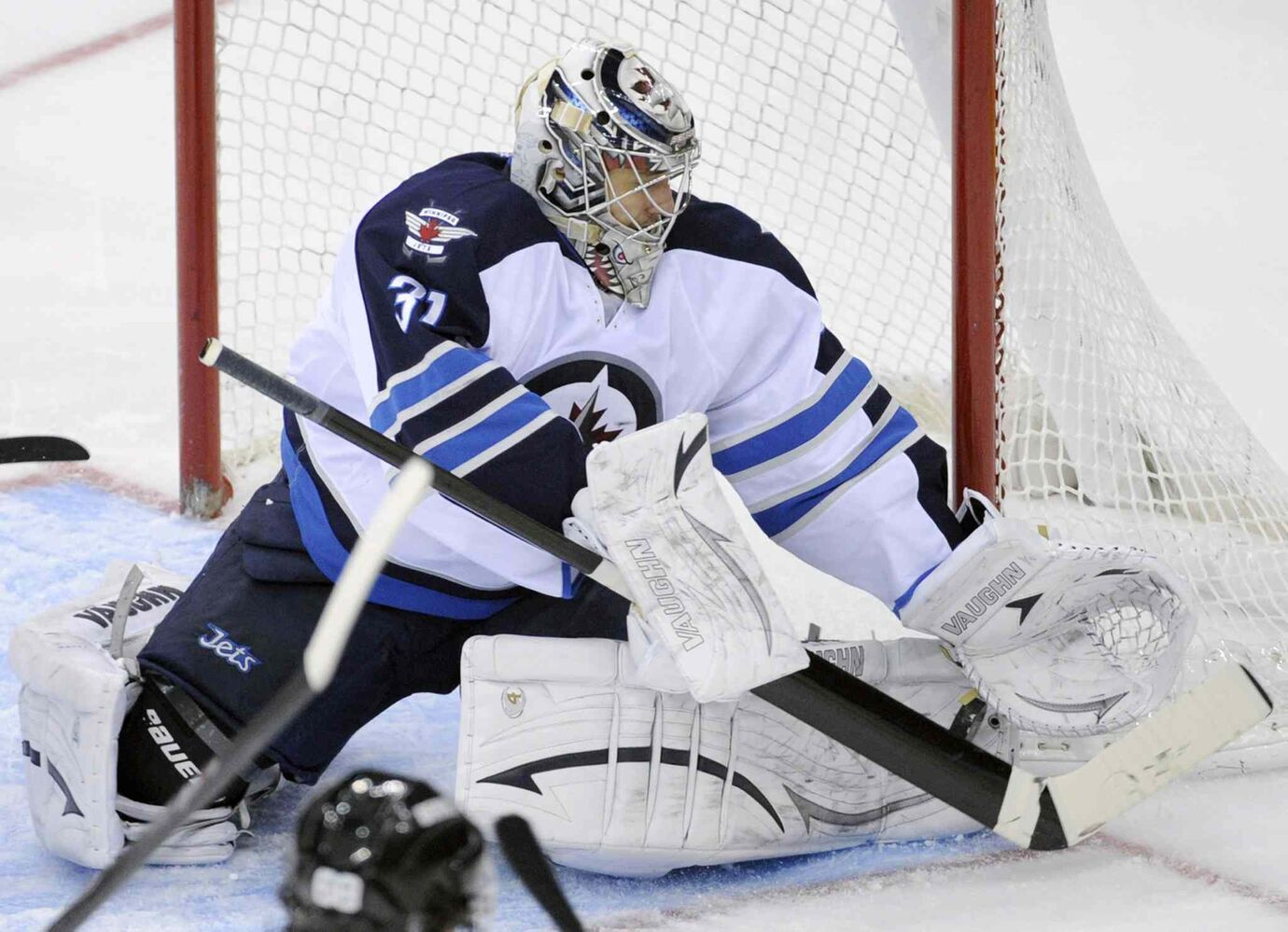 Winnipeg Jets goaltender Ondrej Pavelec makes a save during the third period.