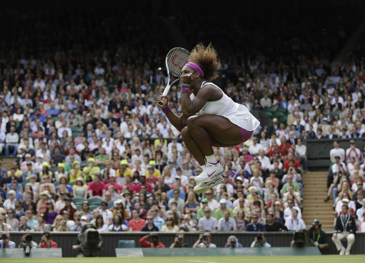 June 30, 2012: - Serena Williams of the United States reacts after winning against Zheng Jie of China during a third round women's singles match at the All England Lawn Tennis Championships at Wimbledon, England.  (Anja Niedringhaus / The Associated Press)