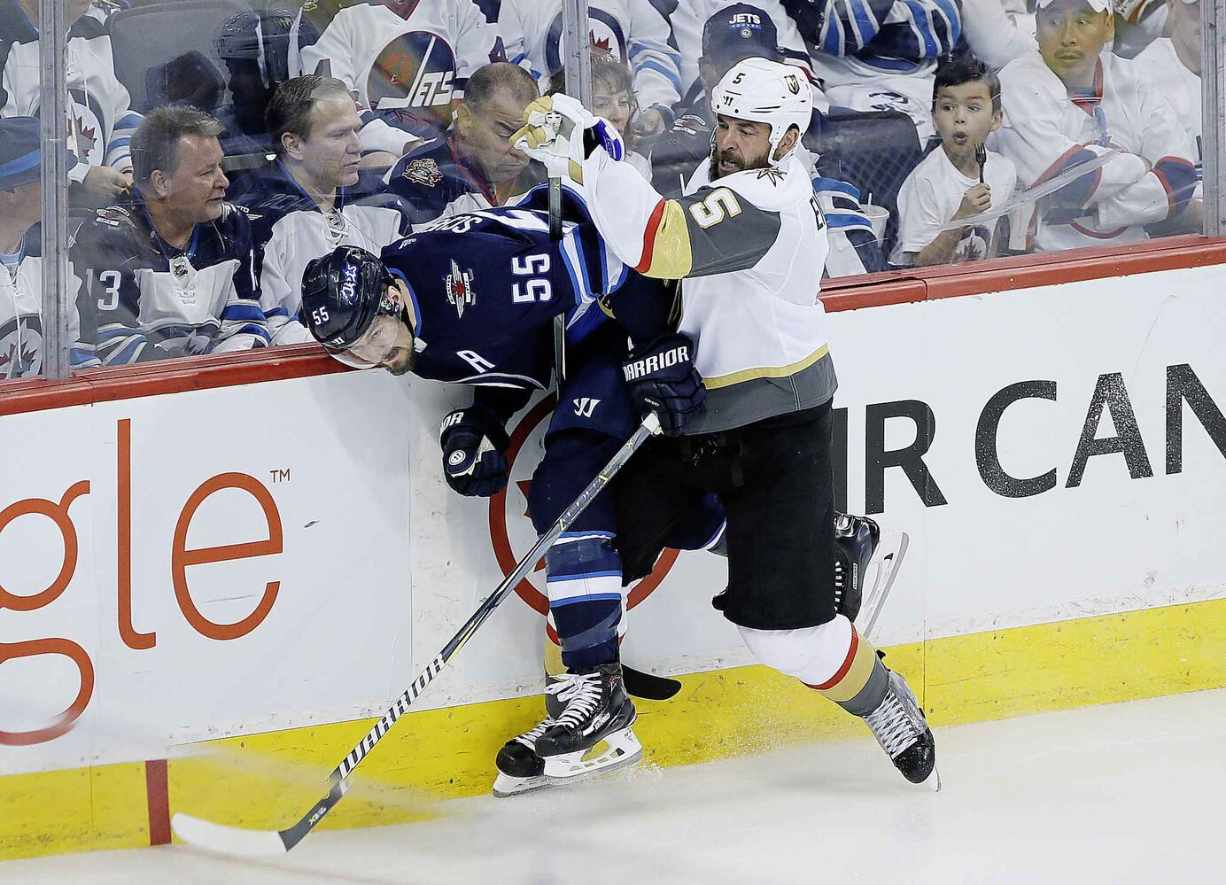 JOHN WOODS / THE CANADIAN PRESS</p><pVegas Golden Knights' Deryk Engelland (5) checks Winnipeg Jets' Mark Scheifele (55) during third period of game one action in the NHL Western Conference Final in Winnipeg on Saturday, May 12, 2018.</p>